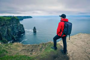 Atlantic way: A visitor takes in the view at the Cliffs of Moher