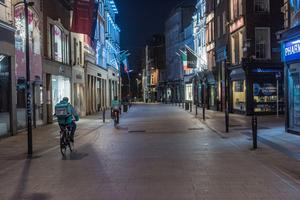Deserted: Food delivery riders on Dublin's Grafton Street as the lockdown continues. Photo: Douglas O'Connor