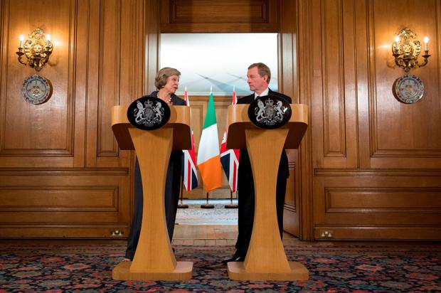 Enda Kenny and Theresa May in Downing Street in July. Photo: Stefan Rousseau/PA