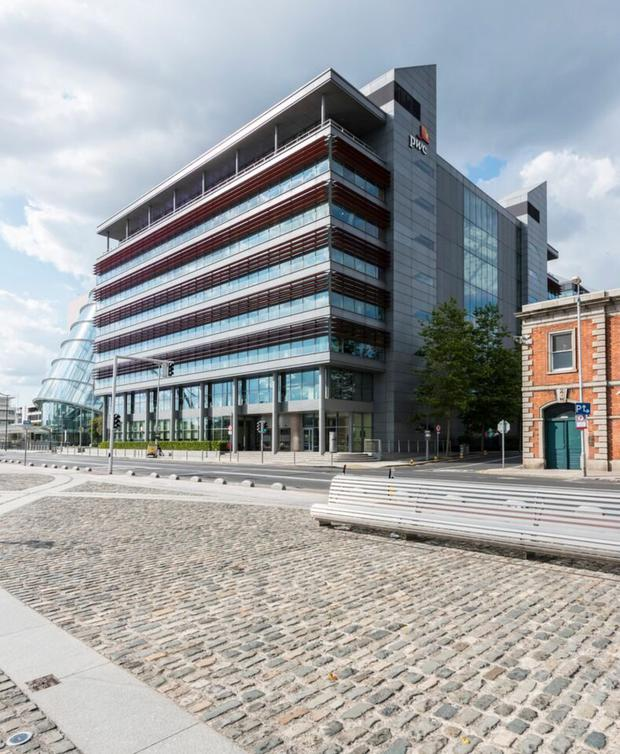The sale of docklands building is described as a 'significant milestone' for the Irish markets