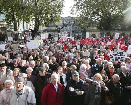 Pensioners' groups protest outside the Dail over the Budget. A UK report suggests OAPs can help regenerate urban centres.
