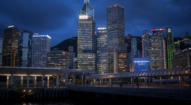 The Hong Kong skyline at night - house buyers are flocking to the market there