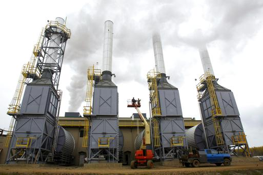 Steam generators stacks Petro-Canada's MacKay River Oil Sands facility about 60 miles north of Fort Mcurray in northern Alberta, Canada. The drop in oil prices has devestated Calgary's office market.