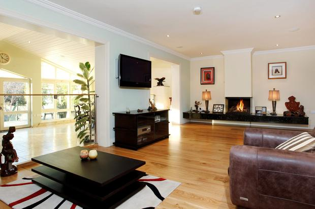 The L-shaped living room with gas inset fire.