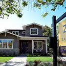 Big Silicon Valley homes are having their prices cut in a sign that the tech boom is slowing down.