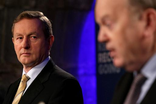 STAYING POWER: Taoiseach Enda Kenny said he will be around for a reshuffle and another few budgets; Michael Noonan is seen as Kenny's brain. Photo: Gerry Mooney