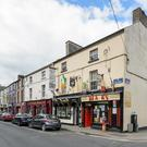 The holding comprises ten buildings on Main Street, Farnham Street and Thomas Ashe Street