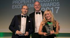 Irish rugby legend Paul O'Connell presents the Emerging Talent Award jointly to Joe McGinley, Iconic Offices, left, and Roisin Lafferty, Kingston Lafferty Design, at the 2017 KPMG Irish Independent Property Industry Excellence Awards, held in the Convention Centre. Photo: Iain White Photography
