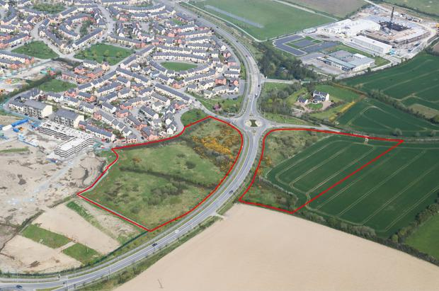 Two plots of land divided by the relief road at the Raheny roundabout, Lusk, were bought by an Irish house builder for around €4.8m