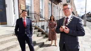 TJ Cronin (right) the newly elected president of the Society of Chartered Surveyors Ireland with his predecessor Micheál Mahon and SCSI CEO Shirley Coulter. Photo: Conor McCabe Photography