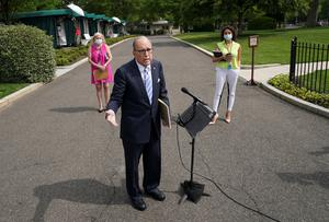 Comments: White House adviser Larry Kudlow talks to reporters yesterday