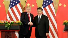 Times change: Presidents Donald Trump and Xi Jinping shake hands in the Great Hall of the People in Beijing, China in November 2017