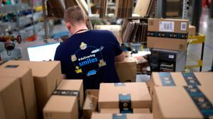 Amazon has led the way for online shopping but customers are now expecting the same approach from small retailers if they want to return their purchases. Photo: Ina Fassbender/AFP via Getty.