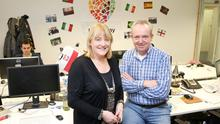 Debbie Flynn and Tom Kennedy in the Homestay.com offices