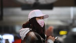 A woman wearing a face mask amid coronavirus concerns (Victoria Jones/PA)