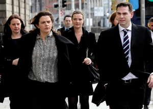 The Quinn children, Aoife, Brenda, Ciara, Colette (partially hidden) and Sean Jr at the Four Courts. Photo: Collins Courts