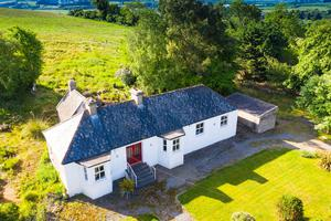 The cottage on an elevated one acre site is available as a seperate lot and has a €300,000 guide price.