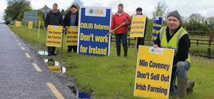IFA members from Co Meath erecting signs at the entrance of Teagasc Grange, to welcome Commissioner Ciolos, Minister Simon Coveney and the EU Agricultural Ministers to the to the beef research station.