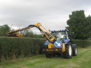 A Moloney operator hedge cutting last month