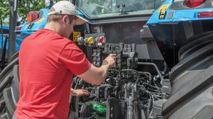 Some companies forbid owners of its highly computerised tractors and machines from performing repairs or allowing anyone else to work on them apart from authorised agents. Stock Image