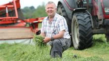 Cutting costs: Darragh Carroll and three other farmers joined forces two years ago to invest in a silage harvester and mower; the group estimate that they are now saving €60 per acre on their silage bills. Photo: Finbarr O'Rourke