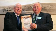 Top honours: Minister Michael Ring TD presenting the Hall of Fame Award to Henry Dudley in 2015