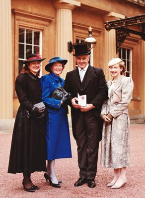 Joe Pat Brunty with his family on the day he received an MBE