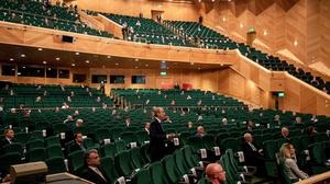 Business as usual: The Dáil sitting in its new venue at Dublin's National Convention Centre