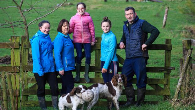 Family farm: John and Fiona Curran with their daughters Mary (18), Anna (14) and Lucy (11) on their organic farm in Fordstown, Co Meath. Photo: Mark Condren