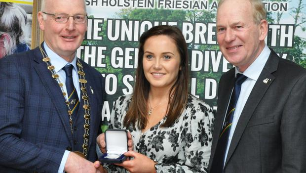 Louise Sinnott, The Ballagh, Enniscorthy, Co. Wexford, winner of the IHFA President's Medal receiving her award from Patrick Gaynor.