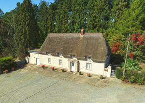 A 104ac residential tillage and grass farm with a two-storey, listed thatched farmhouse, at Coolatore, Ferns in Co Wexford sold as an entire at auction  making €1.55m or almost €15,000/ac.
