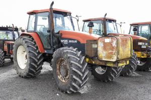 A 1998-registered New HollandT M135 Tractor with 7,534 hours and single wheels front and back