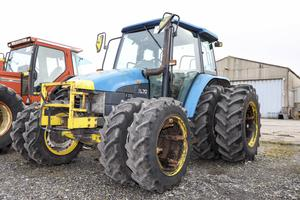 A 1999-registered Ford New Holland TL70 4WD Tractor with 7,877 hours on the clock and fitted with dual wheels front and rear