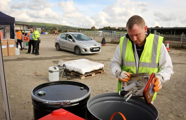 Alan Ennis sorts through syringes to be recycled at the EPA/ ENVA hazardous waste collection in Carnew Mart, Co Wicklow. Photo: Garry O'Neill