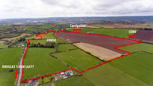 A 101ac residential farm on the outskirts of Cork city sold for €5.8m or €58,000/ac at auction.