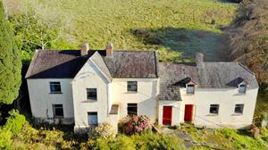 The period building with the farm for sale at Caher, Co Clare