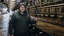 Spic and span: Fiachra Liston in the 32-unit milking parlour. Photo: Don Moloney