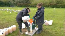 Teagasc staff preparing of urine treatments for field application