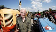 Pat Egan surrounded by some of the 100 tractors in his collection. Image: Kevin Byrne