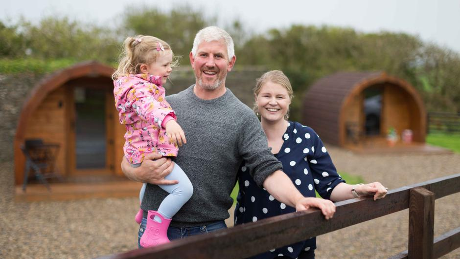 Plans: Joanne and David Russell with Sadhbh (3) at Doonbeg Pods and Cottages. Photograph by Eamon Ward