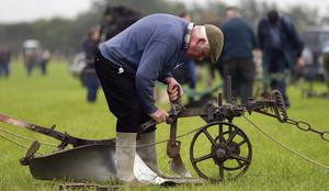 THE GOOD EARTH: Gerry King from Co Louth uses traditional techniques at the National Ploughing Championships in Ratheniska, Co Laois. Photo: Niall Carson