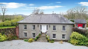 The house, which can be bought in a separate lot or as an entire, is reached by a set of stone steps to the upper floor, while other accommodation is at garden level