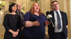 Alliance Party leader Naomi Long, centre, speaking to the media at Stormont after talks with Prime Minister Theresa May (David Young/PA)