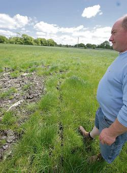 Seamus Quigley surveys one of the areas where water was trapped until he cut tracks with the mole plough
