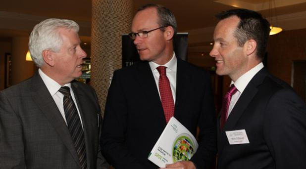 Line-up: Minister for Agriculture, Simon Coveney, pictured with John Horgan, Kepak Group and Meath football manager Mick O'Dowd at the ASA conference at the Tower Hotel, Waterford.