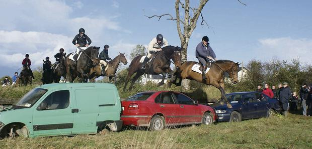 OBSTACLE: Irish international showjumper Bertram Allen (front left) tackles one of the challenging jumps in the Dromin Athlacca Charity Ride 2013, in aid of the JT McNamara Fund and other charities