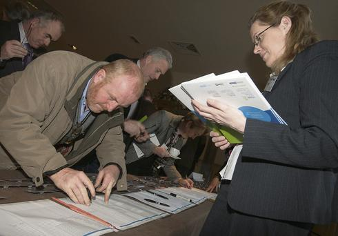 Gerry Farrell, Roscommon Co-operative Livestock Mart registering with Sinead Farrell at the 37th ICOS National Conference in Portlaoise