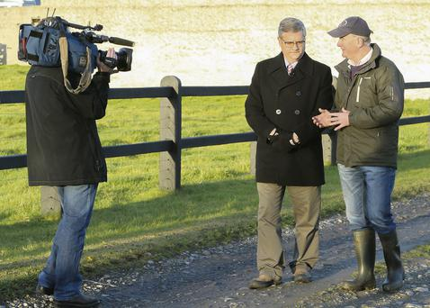 IN THE SPOTLIGHT: Robin Talbot is interviewed on his farm in Ballacolla, Co Laois by Jim Boulden, CNN's international business correspondent as part of a series of programmes which the cable news channel is running about Ireland's exit from the financial bailout programme later this week
