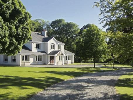 OPPORTUNITY: This 49ac residence near Gorey comes with five bedrooms, an entrance hall, kitchen, lounge and dining room and is expected to fetch €1.3m.
