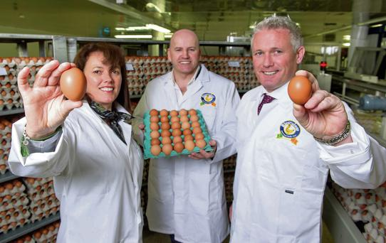 Mary and DJ Kelleher of Riverview Eggs with Sean Gallagher. Photo: Michael Mac Sweeney